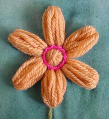 Yarn petals grouped into six embroidered petals