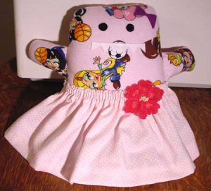 Soft toy monster in a pink flowery skirt