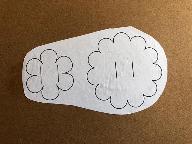 Paper flower templates stuck onto scrap cardboard