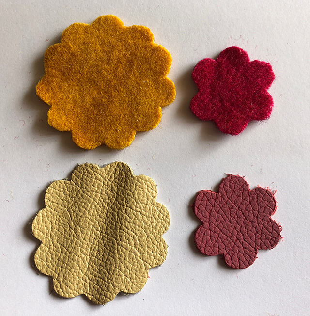 Flower shapes cut from boiled wool felt and leather