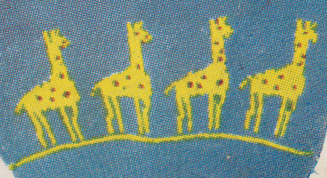 Dtail of giraffe pattern with placement of spots and eye in duplicate stitch embroidery