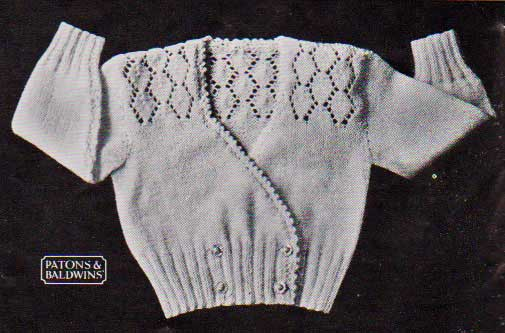 Knitted baby cardigan sweater with diamond lace patterning