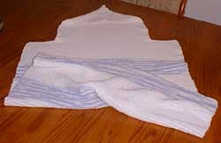 Knitted baby towel laid flat