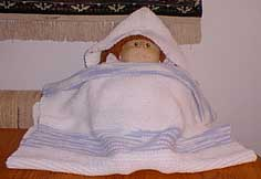 Knit hooded baby towel with doll
