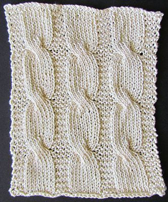 Cabled knit blanket panel knit from a Victorian era knitting pattern.