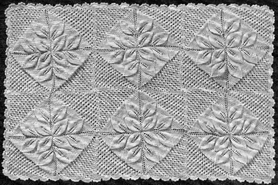 Baby blanket made up of 24 individual squares with a crochet border and embossed leaf design