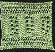Knitted lace insertion with geometric design