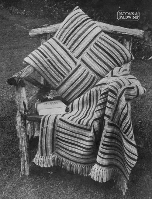 Knittede blanket and cushion made from striped squares