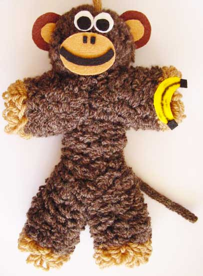 Toy monkey made on a flower loom