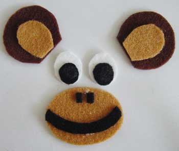 Face and ears cut from felt