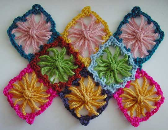 Diamond flower loom motifs with multi-color crochet edging