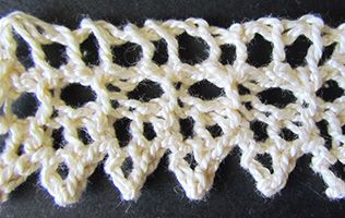Tiny lace knit edging knitted from a Victorian era knitting pattern