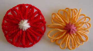 Loomed yarn flowers with oversewn centres