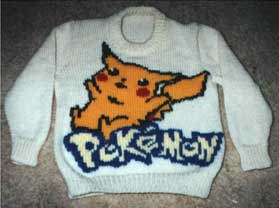White sweater with Pikachu the Pokemon knit on the front