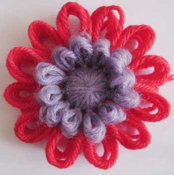 Loomed flower with a puffy centre.
