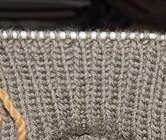 Knit 1, purl 1 ribbing on a knitting needle.