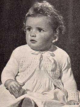 Long sleeved baby cardigan with eyelet patterning and ribon closure