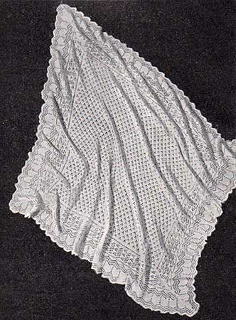 shetland baby shawl with dotted lace centre and wave patterned border