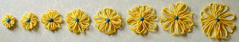 Eight of the ten sizes of flower that can be made on the Cottrell adjustable flower loom