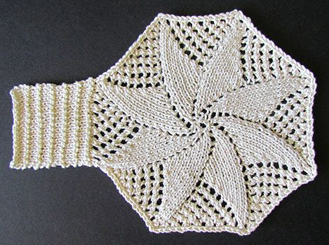 Knitted lace star motif knit from a Victorian era knitting pattern.