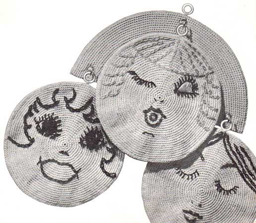 Three circular pot holders with embroidered faces