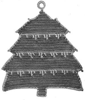 Potholder in the shape of a pine tree cpovered in snow