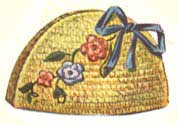 yellow tunisian stitch tea cozy with flowers and a bow
