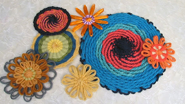 A collection of loomed flowers with double weaving