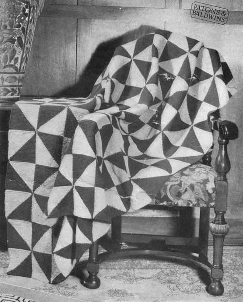 Modular knit blanket and cushion with triangle design