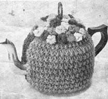 Vintage knit tea cosy with flowers