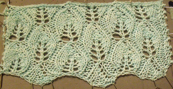 Knitted swatch with leaf pattern