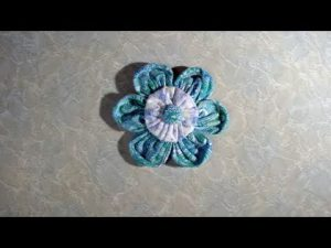 Suffolk puff or fabric yo-yo flower