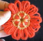 Loomed flower with crochet centre
