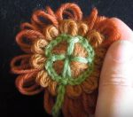 Loomed flower with shamrock crochet centre