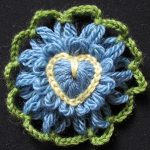 Loomed flower with heart crochet centre