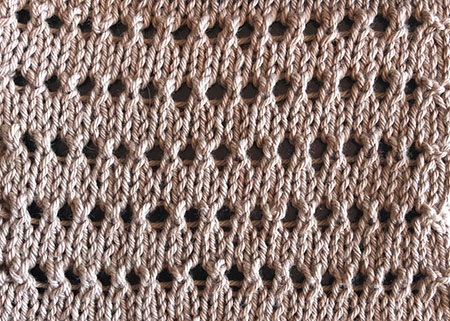 A swatch of knitted pineapple stitch.