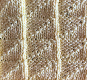 A triangular knit and purl stitch swatch.