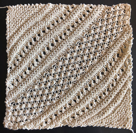 Lace square for a knitted blanket