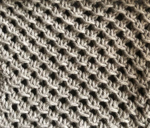 Knitted swatch in lattice stitch