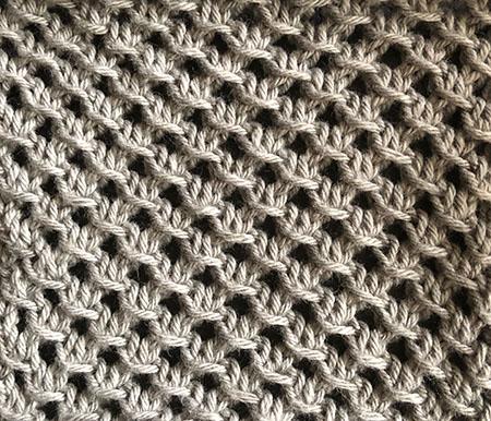 Knitted swatch in lattice stitch