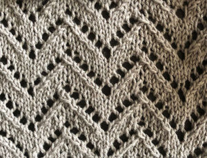 Knitted swatch in lace chevron stitch