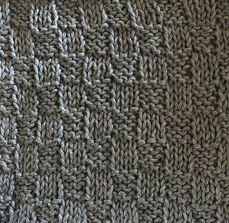 Knit/purl swatch with small checks.