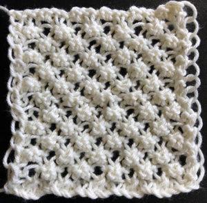 A knit swatch of arachne stitch