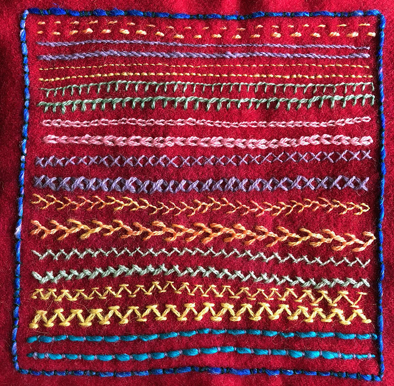 Wool blanketing sampler with various line stitches worked in wool thread.