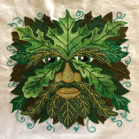Green man embroidered sampler