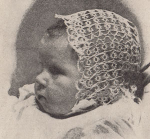 A tatted baby bonnet from New Zealand in the 1940's