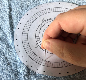 Making the holes in a paper pin template