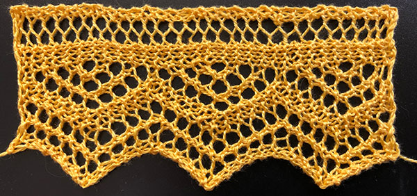 Hand knit lace edging with triangle and zig-zag design