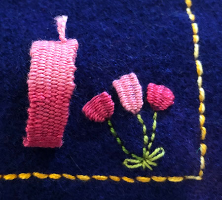 Various woven embroidery stitches on a background of dyed woollen blanket.