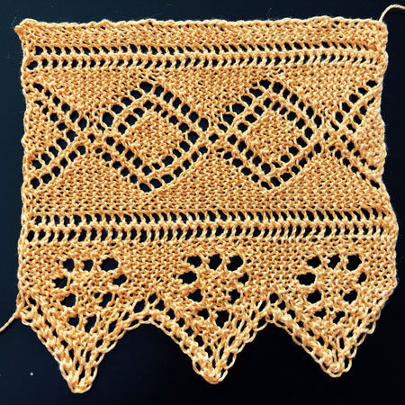 Knitted lace border with eyelet pattern of double diamonds and pennant flags